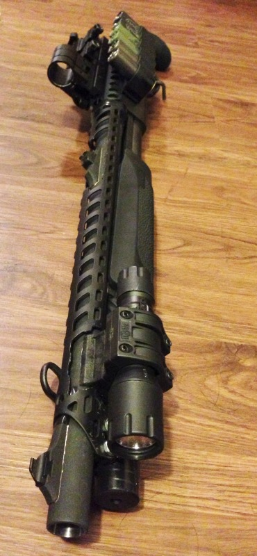 Remington 870 Shotgun with Heatshield, Sidesaddle, Holographic Sight