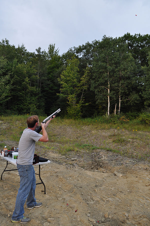 Remington 870 Marine Magnum - Magpul Stock & Forearm@ Clay pigeon in view
