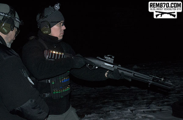 Shooter with shotgun with flashlight and holographic sight