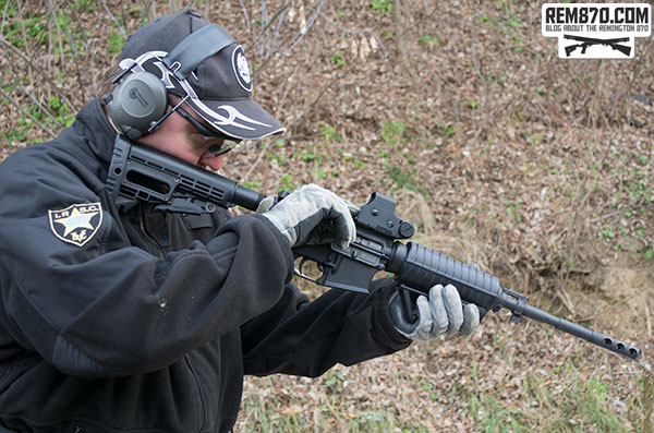 Shooter with AR-15 Rifle with Eotech