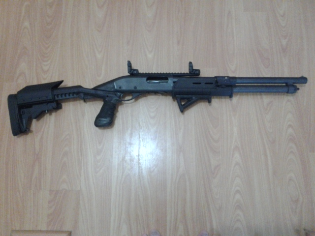 """Remington 870 with Knoxx Stock, SuperCell recoil pad, Magpul forend, Magpul AFG2 angled foregrip, Mesa Tactical 9"""" MIL-STD 1913 Picatinny rail"""